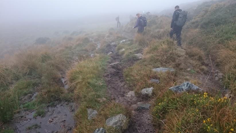 Thick fog as Vertical Leap colleagues walk through Dartmoor