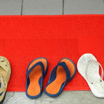 Conceptual image of peoples shoes outside a door reflecting website visits