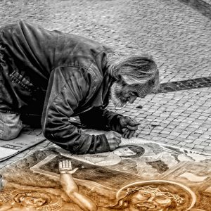 Man painting on the street 0 using images in content
