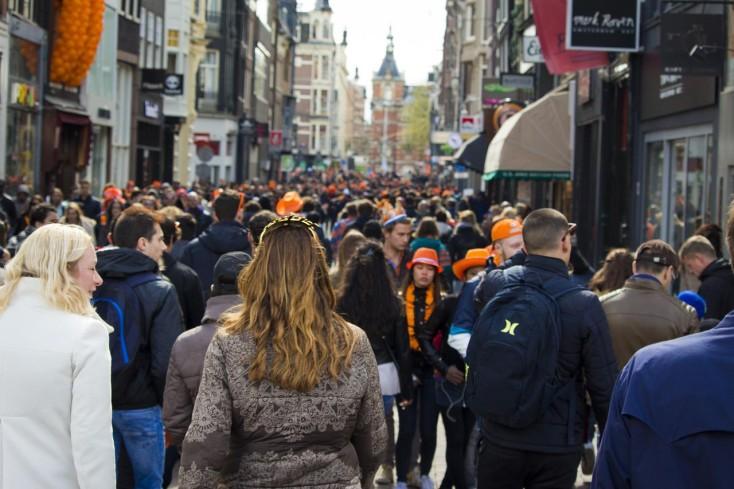 People walking through busy street