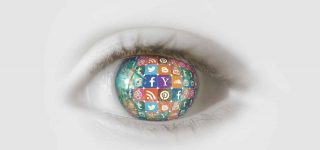 Human eye where the lens is filled with the icons of social media websites such as Yahoo, Facebook, Twitter, Instagram, Pinterest, Tumblr, Google Plus and YouTube