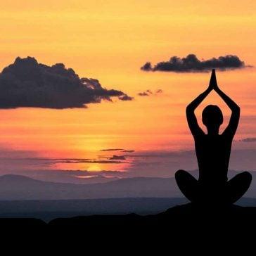 Yoga pose in sunset image to accompany partnership with Solent Mind blog