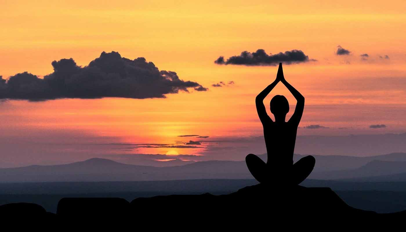 Yoga pose in sunset image to accompany partnership with Solent Mind blog