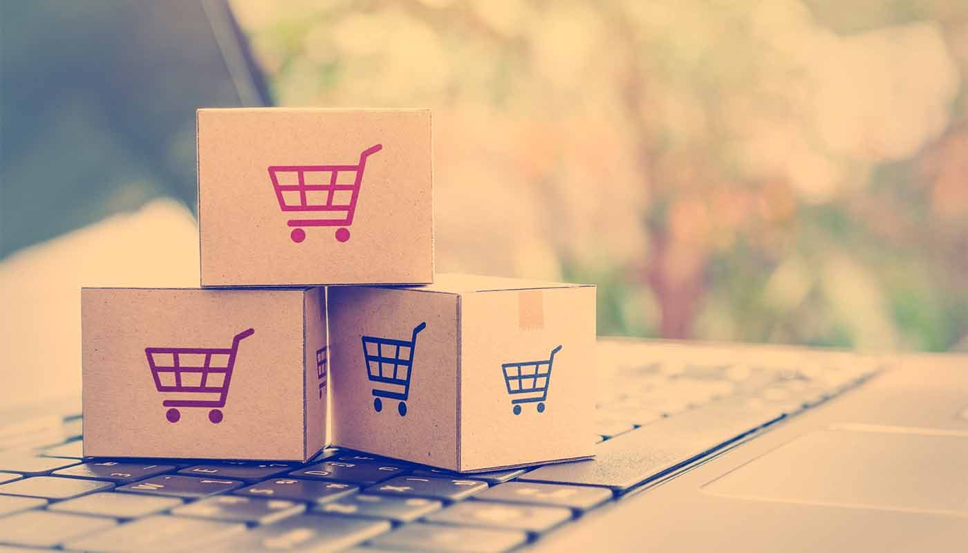 Online shopping boxes on keyboard