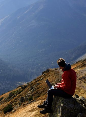 Codestone SEO and PPC case study header image showing someone using their laptop in the mountains