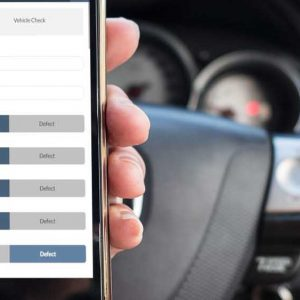 On the road holding phone showing a PODFather work management app