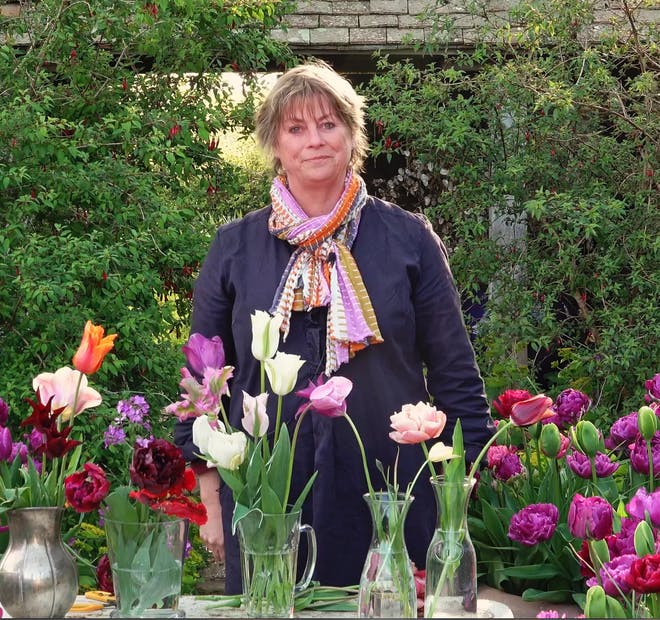 Sarah Raven standing by flowers