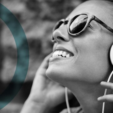 Girl listening to podcast on headphones