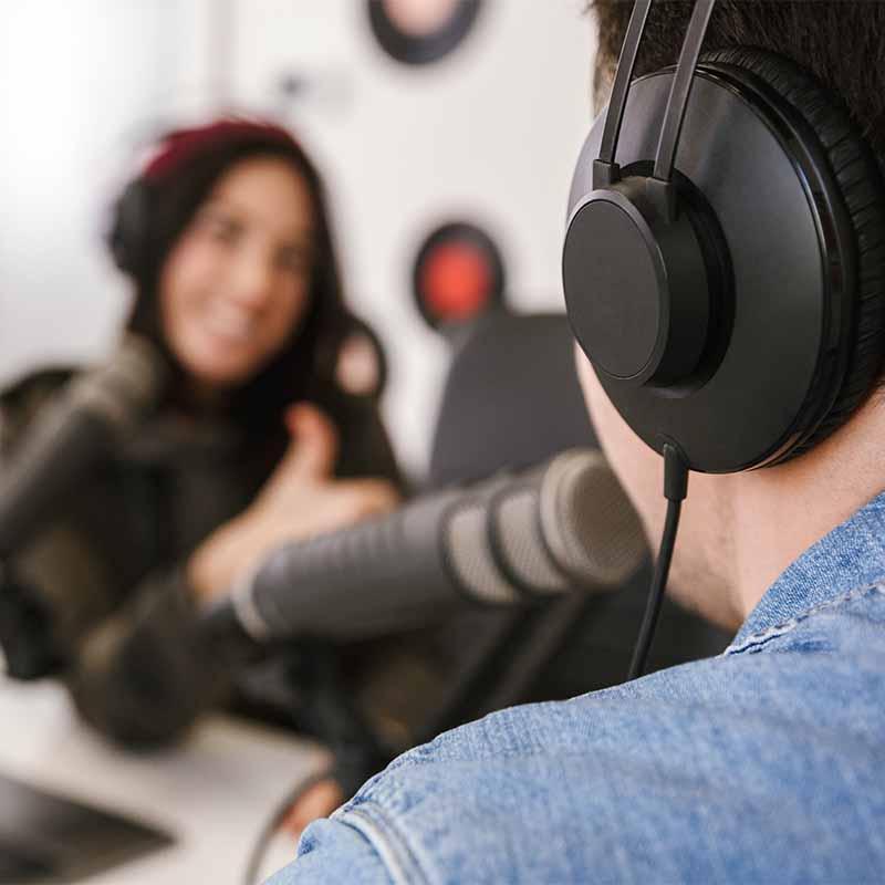 man recording podcast